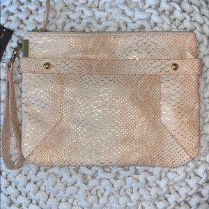 The limited Clutch and Wristlet.